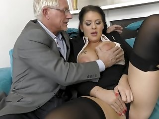 Busty brunette sucks an older dick of her accidental lover