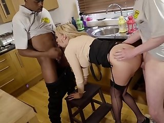 A stacked housewife satisfies two men with her mouth and cunt